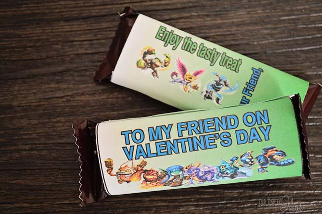 Get these free printables for Skylanders Valentine candy bar wrappers. Such a fun idea from OurThriftyIdeas.com