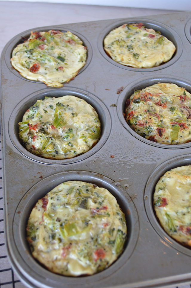 broccoli and sun dried tomato egg cups made using just egg whites. A fun and quick breakfast that even the kids love.