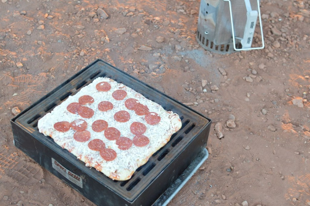 Cooking Pizza while camping, using a charcoal grill