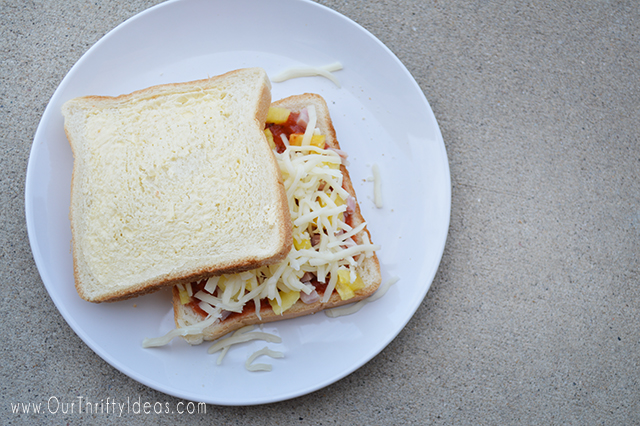 These Pizza Pocket Sandwiches can be cooked over an open fire, or grill. They are great for a backyard cookout or while camping! Can't wait to have these this Summer.