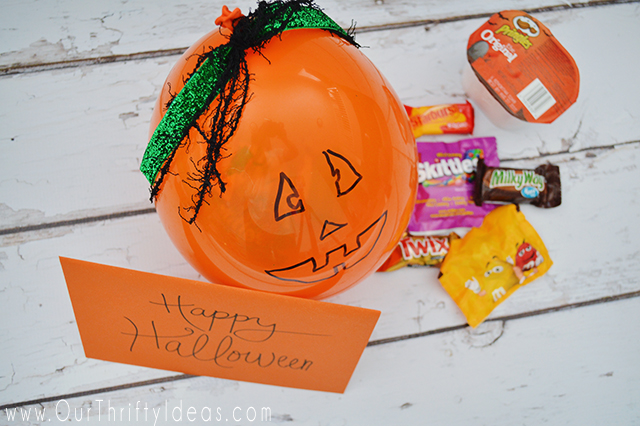 Balloons filled with candy and made to look like pumpkins. What a fun and creative way to do the doorstep booing this year!