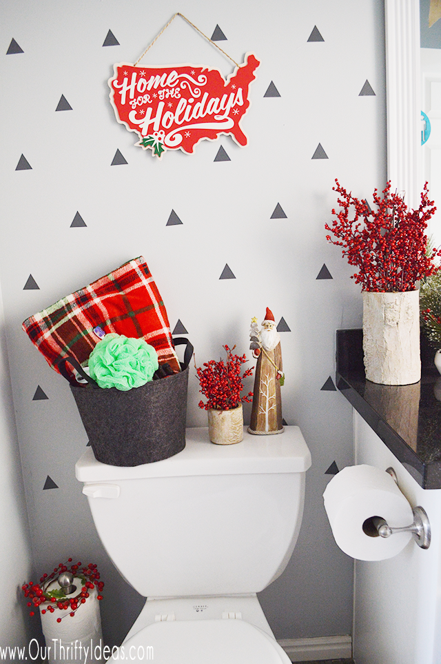 A little Christmas cheer in this bathroom decor